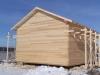 Дом укрыт парогидроизоляцией и готов к дальнейшей отделке.
